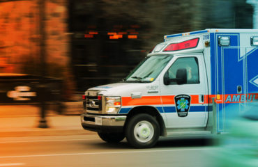 ambulance speeding down a street