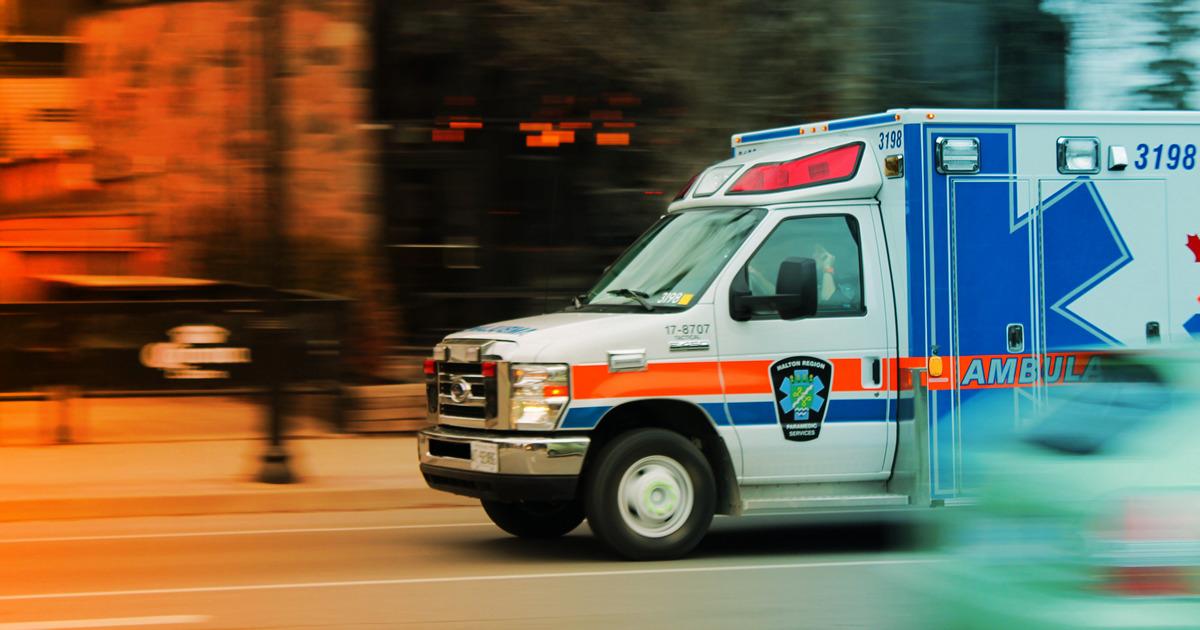 ambulance speeding down a street