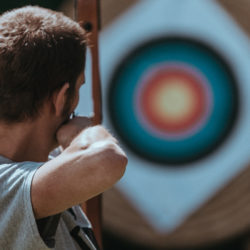man with bow and target - adherence targeting