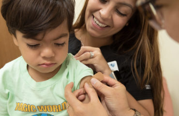 boy receiving vaccination shot - immunization