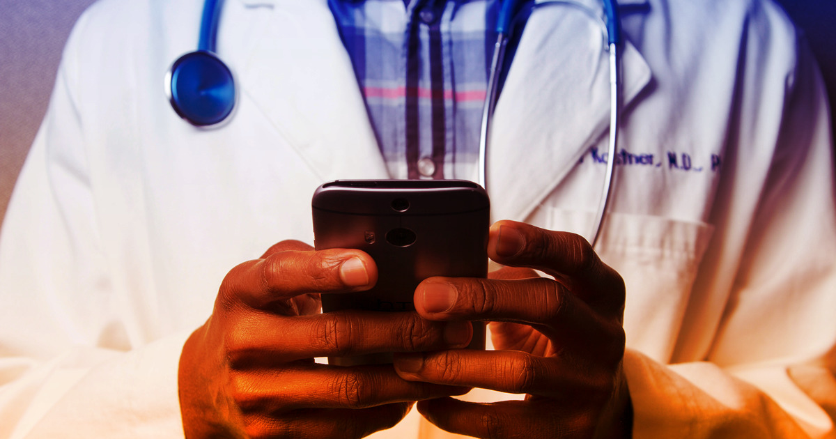 doctor on cellphone - Medicare open enrollment plan comparison and selection