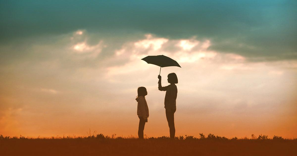 silhouette of girl holding umbrella