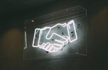 handshake - neon sign - customer loyalty