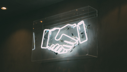 handshake - neon sign - customer loyalty