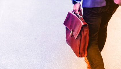 man walking with briefcase - business intelligence for pharmacies