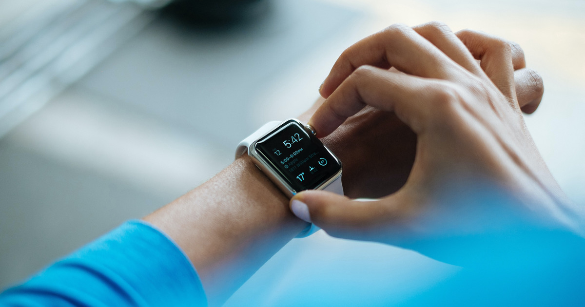 man checking apple watch - consumer-driven health care
