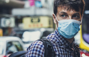 man wearing facemask - how pharmacies can help