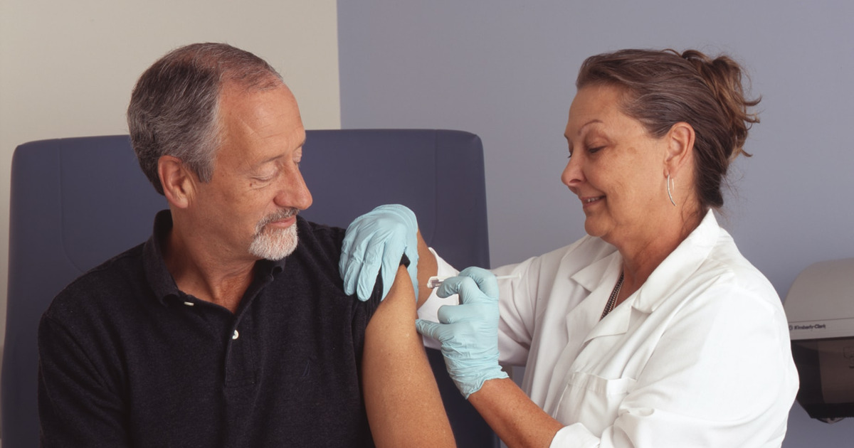 man getting vaccine - clinical care