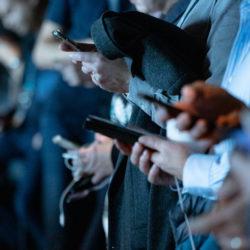 social media engagement - people holding smartphones