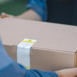 prescription delivery program - person handing customer a box