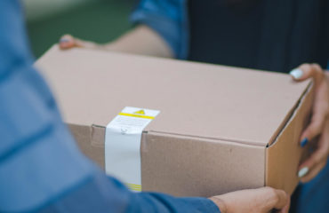 prescription delivery program - person handing customer a box