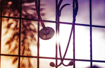 stethoscope hanging on fence - medicare open enrollment